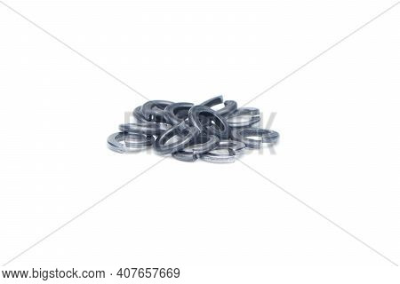 Group Of Chrome Metall Slim Washers Isolated On White Background. Close Up View