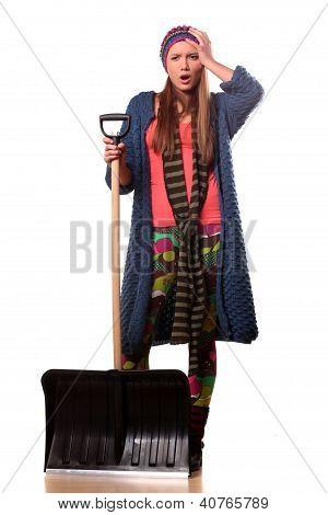 girl with a snow shovel