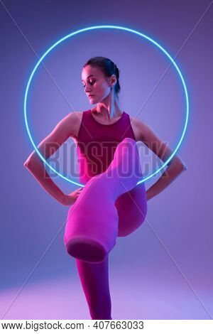 Fashion. Young And Graceful Ballet Dancer Isolated On Purple Studio Background In Neon Light With Gl