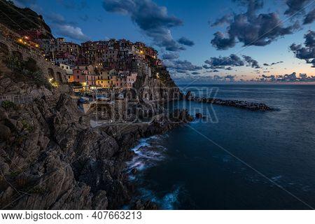 Manarola Village At Sunset On Mediterranean Sea In National Park Cinque Terre, La Spezia, Liguria, I