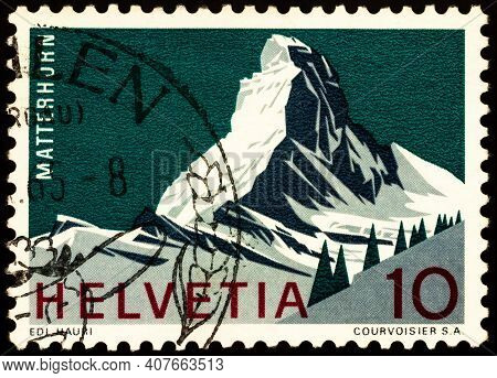 Moscow, Russia - February 09, 2021: Stamp Printed In Switzerland Shows Matterhorn Mountain, 4,478 Me