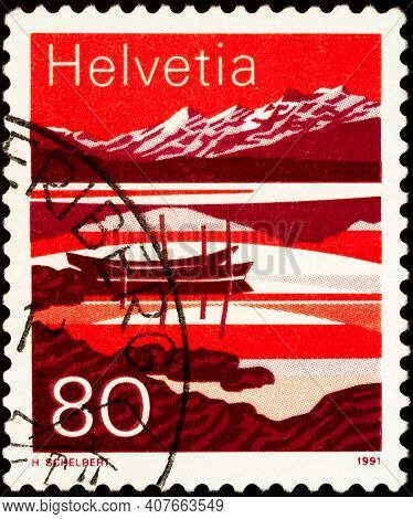 Moscow, Russia - February 10, 2021: Stamp Printed In Switzerland Shows Melchsee, Lake In Switzerland