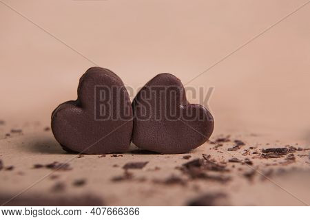 Two Handmade Chocolate Hearts On Craft Background With Crisps. Valentine S Concept, Copy Space
