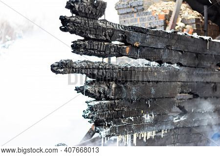Charred Wooden Walls Of A House After A Fire. Burnt Boards In A Burnt Down Building. Background With