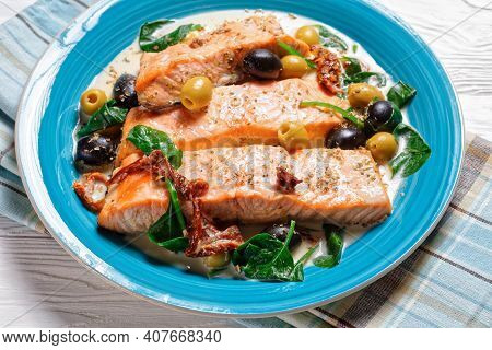 Salmon Stew With Cream Sauce, Sun-dried Tomatoes, Olives, And Spinach, Dried Oregano Served On A Tur