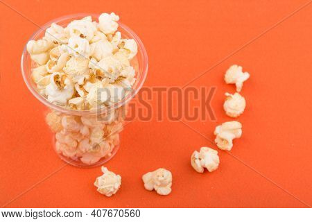 Heap Of Delicious Salty Popcorn, Isolated On Orange Background.