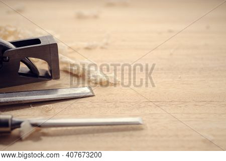 Carpentry Or Woodworking Background With Copy Space. Carpentry Tools And Wood Shavings On A Table. W