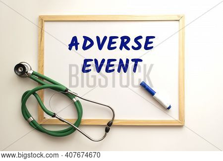 The Text Adverse Event Is Written On A White Office Board With A Marker. Nearby Is A Stethoscope. Me
