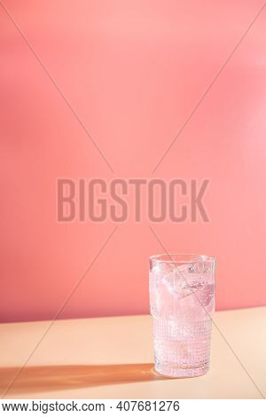 Summer Refreshment Pink Drink With Ice. Light Pink Rose Cocktail On A Pink Background With Bright Sh