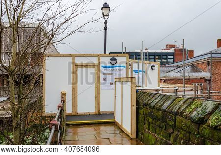 Chester; Uk: Jan 29, 2021: Temporary Hoardings Have Been Erected On Parts Of The Historic Chester Ci