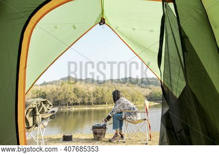 A Traveling Woman Is Cooking In Camping , Travel Destination , Nature Tourism Concept