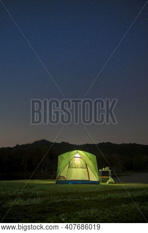 Stunning Scenery Of Beautiful Night Sky With Stars Over  Tent Camp, Travelling And Camping Concept
