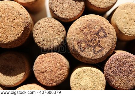 Lot Of Cork Texture Bottle Bungs Background. Cross Symbol.