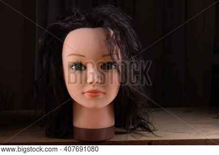 Mannequin Of A Female Head. Doll Head With Hair. Female Doll With Green Eyes. Brunette Doll.