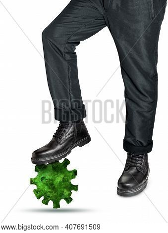 Man In Leather Boots Steps On A Model Of The Virus. The Concept Of Defeating Coronavirus Or Flu. Iso