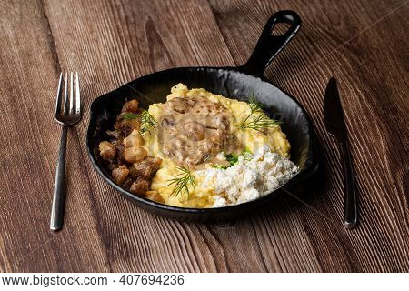 Banosh - A Traditional Dish In The Western Ukraine Made Of Cornmeal. Served In A Black Pan With Crac