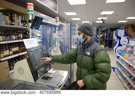 Sheffield, United Kingdom, 14th January, 2021: Young Man Wearing A Face Mask And Winter Clothes Pays
