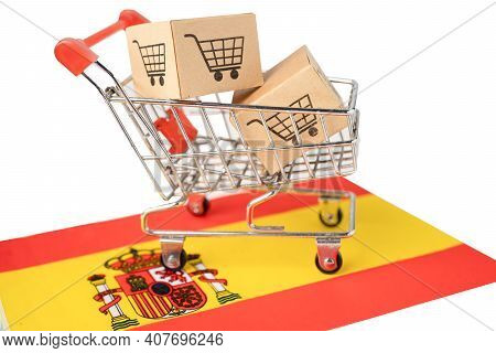 Box With Shopping Cart Logo And Spain Flag, Import Export Shopping Online Or Ecommerce Finance Deliv
