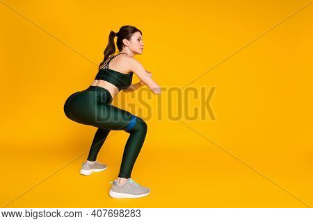 Photo Of Sporty Lady Butt Workout Stretch Resistance Rubber Stripe Wear Sports Suit Isolated Yellow
