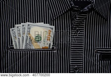 Money In Your Pocket. 100 Dollar Banknotes. Pocket Of Striped Shirt And American Money In It. Cash P