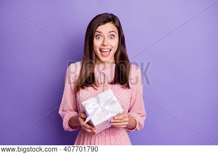Portrait Of Attractive Amazed Cheerful Girl Holding In Hands White Giftbox Isolated Over Bright Viol