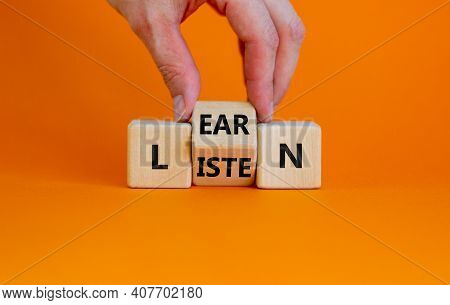 Listen And Learn Symbol. Businessman Turns A Wooden Cube And Changes The Word 'listen' To 'learn'. B