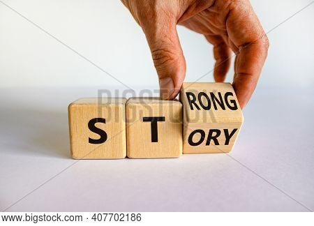 Strong Story Symbol. Businessman Turns Wooden Cubes With Words 'strong Story'. Beautiful White Backg