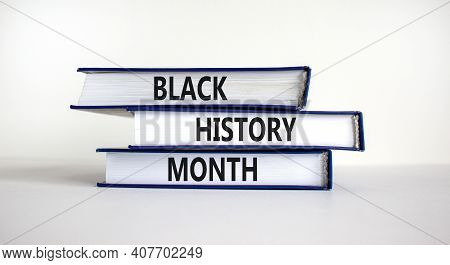 Black History Month Symbol. Books With Words 'black History Month'. Beautiful White Table, White Bac