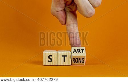 Start Strong Symbol. Businessman Turns Wooden Cubes With Words 'start Strong'. Beautiful Orange Back