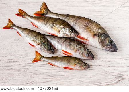 Fresh Small River Fish Roach Lies On A Wooden Surface.