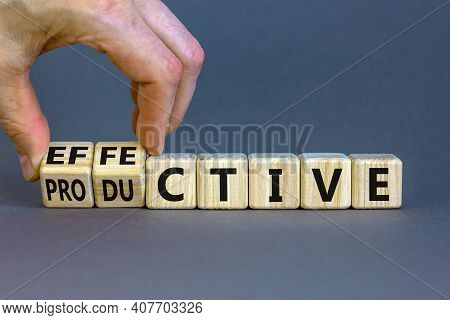 Effective And Productive Symbol. Businessman Turns Wooden Cubes And Changes The Word 'productive' To