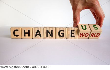 Change World Or Us Symbol. Businessman Turns Wooden Cubes And Changes Words 'change World' To 'chang