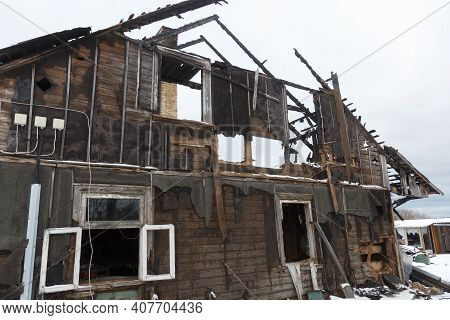Burnt Wooden House. House After The Fire. House Destroyed In A Gas Explosion .