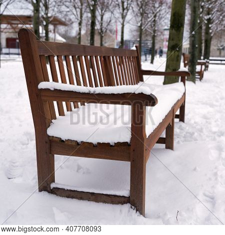 Snowed In Park Bench In A Public Park In Magdeburg In Germany In Winter Time