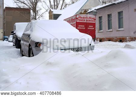 Magdeburg, Germany - February 08, 2021: Snowed-in Cars In A Street In The City Center Of Magdeburg I