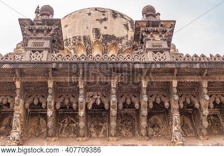 Vijayapura, Karnataka, India - November 8, 2013: Closeup Of Extensive Brown Stone Sculptures Under R