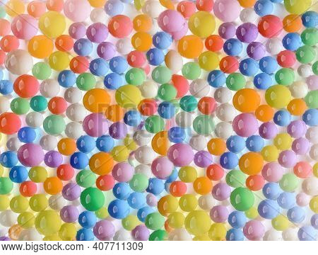 Abstract Multicolored Cheerful Background With The Texture Of Hydrogel Balls. Water Absorbent Balls