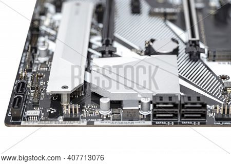 Macro Shot Of A Silver Heat Sink Dissipating Heat From The Chipset On The Motherboard Of A Desktop C