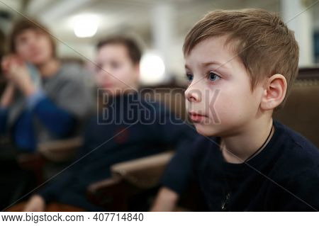 Portrait Of Child Watching Performance In Theater