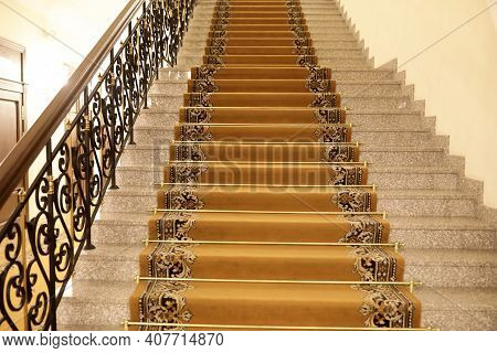 Details Of Brown Carpeted Staircase