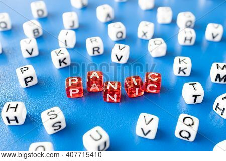 Letters On The Cubes Laid Out The Word Panic, All Around The Word White Cubes With Letters, Close-up