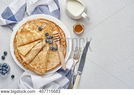 Crepes, Thin Pancakes Or Blini With Berries In White Plate. Top View. Pancake Week. Shrovetide. Spac