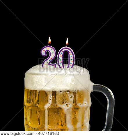 Number 20 Candle In Beer Mug For Birthday Celebration Isolated On Black