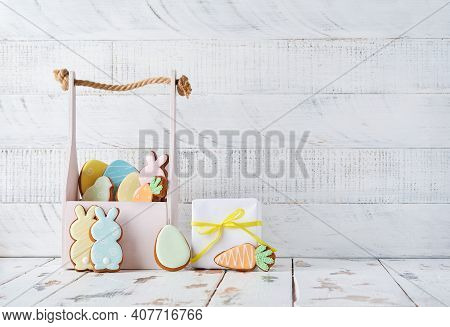Easter Greeting Card With Colorful Colorful Rabbits, Eggs, Chickens And Carrots Gingerbread Cookies