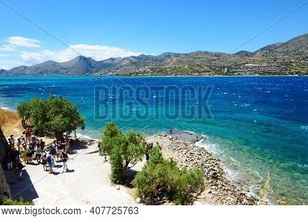 Spinalonga, Greece - May 14: The Tourists Are On Spinalonga Island And View On Crete Island On May 1