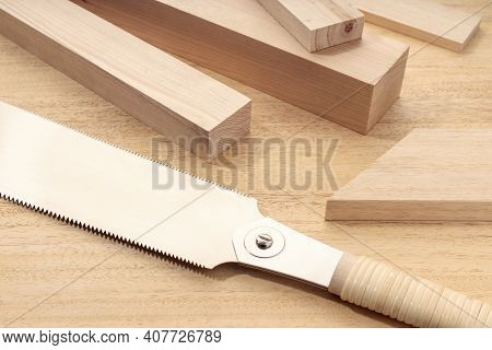 Group Of Assorted Wood Material And A Japanese Hand Saw. Carpentry Timber Material Cut Or Woodwork C