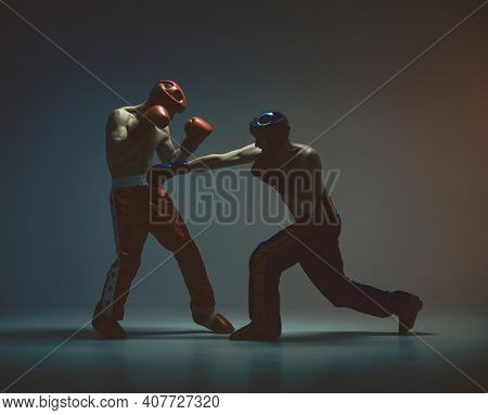 Wrestling Of Two Fighting Males In Helmets And Boxing Gloves In Studio, Martial Arts, Mixed Fight Co