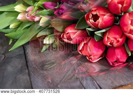 Bunch Of Fresh Colorful Tulips On Old Wooden Boards. Spring Background For Mothers Day And Easter Wi