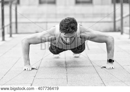 Caucasian Athlete Man Doing Push-ups. Fitness Man Training Push Up Outdoor. Young Handsome Man In Sp