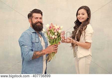 The Best Dad. Father And Daughter With Flowers. Happy Family Portrait. Girl Greeting Dad With Father